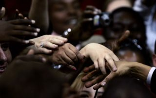 Supporters reach out to touch the hand of democratic presidential candidate Senator Obama (D-IL) after he spoke at a rally in Dallas